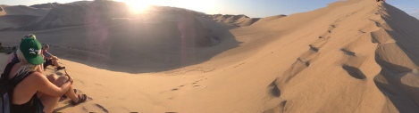 Admiring the sunset view from atop a sand dune in Huachchina!